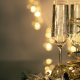 Champagne glasses with golden ribbons